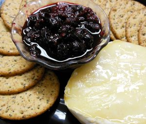 Baked Brie cheese with a fruit compote and crackers